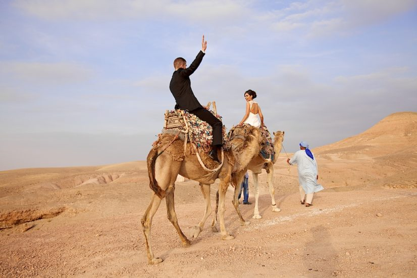 wedding in Marrakech La Pause camel ride ©lasdecoeur
